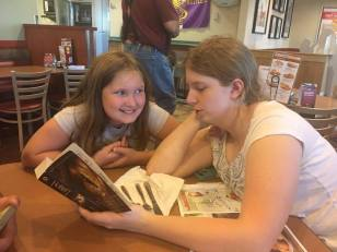 Introducing her to great literature at Denny's