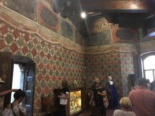 Walls painted to look like tapestries